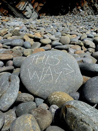Hand written note on a large pebble says This Way on Sandymouth beach, Cornwall. Soaking Up The Sun Beach Photography Enjoying Life Enjoying The Sun