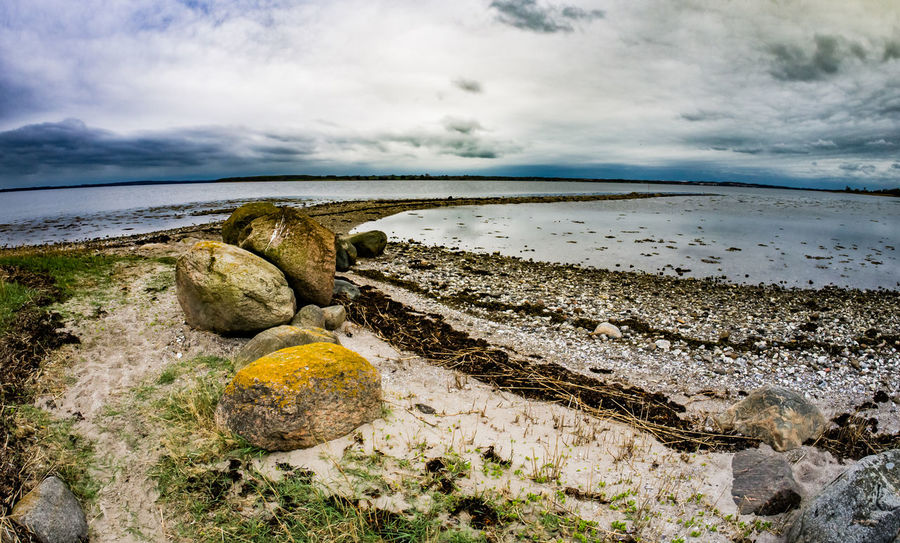Sky Cloud - Sky Rock Beach Rock - Object Beauty In Nature Water Solid No People Scenics - Nature Sea Non-urban Scene Horizon Over Water Tranquility Tranquil Scene Land Nature Day Horizon Outdoors