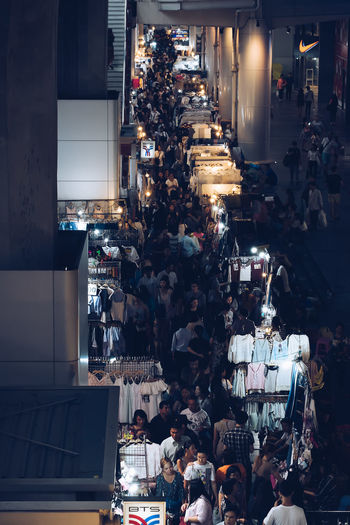 High Angle View Of Crowd At Street Market During Night