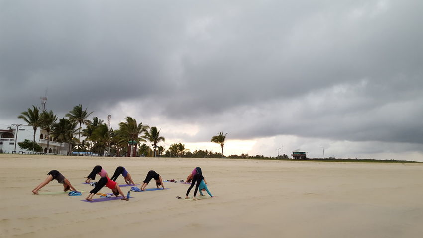 Beach Beach Yoga Cloud - Sky Cloudy Ecuador Galapagos Galapagos Islands Islandlife Leisure Activity Lifestyles Mixed Age Range Overcast Sky Sunrise Tourism Travel Destinations Vacations Weather Yoga Yoga On The Beach Yoga Pose Yoga Practice Yoga Retreat Alternative Fitness