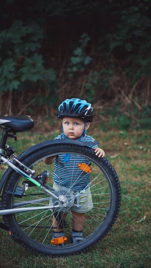 Portrait of boy riding bicycle