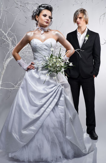 Beautiful bride and groom. Winter theme. Studio shot Bridal Photoshoot Classic Elegant Fashion Frozen Groom Stylish Suit Wedding Winter Beautiful Woman Blond Bridal Bouquet Bride Bride And Groom Brunette Caucasian Couple - Relationship Hairstyle Pose Studio Shot Wedding Dress Wedding Dresses Women Young Adult