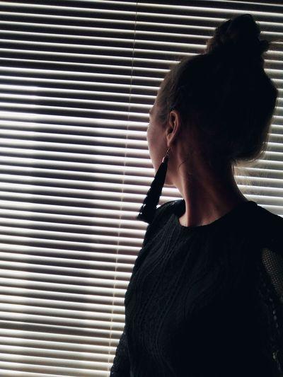 Close-up of woman wearing tassel earring