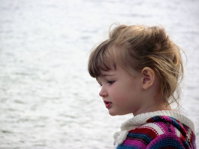 Side View Of Cute Girl Against Sea