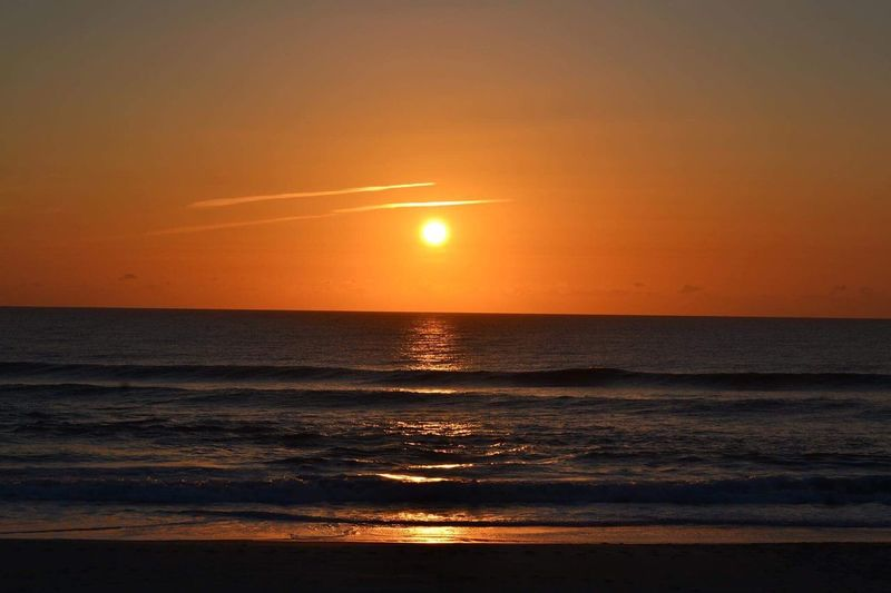 Sunrise on the Gold Coast Australia is truly Beautiful - sometimes even looking like a Sunset Sea Beauty In Nature Scenics Horizon Over Water Nature Orange Color Tranquil Scene Sun Water Beach Reflection Tranquility Idyllic Majestic Sky Silhouette Outdoors No People Travel Destinations