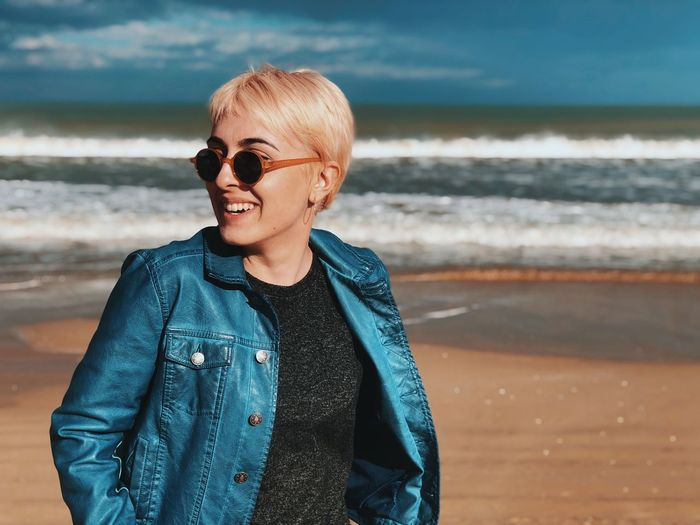 Sea Water Real People One Person Leisure Activity Lifestyles Casual Clothing Standing Land Fashion Beach Front View Glasses Sunglasses Jacket Outdoors Girl Portrait Outfit Blue Smile Smiling