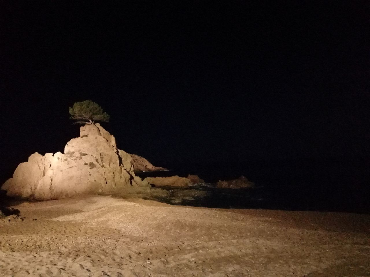 night, copy space, land, sky, nature, no people, beauty in nature, landscape, scenics - nature, rock, desert, tranquility, clear sky, rock - object, tranquil scene, solid, environment, rock formation, outdoors, dark, arid climate, climate