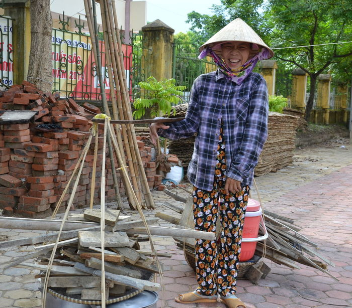 Adult Carrying Day Full Length Looking At Camera One Person Outdoors Portrait Real People Standing Vietnam Vietnam Travel Working