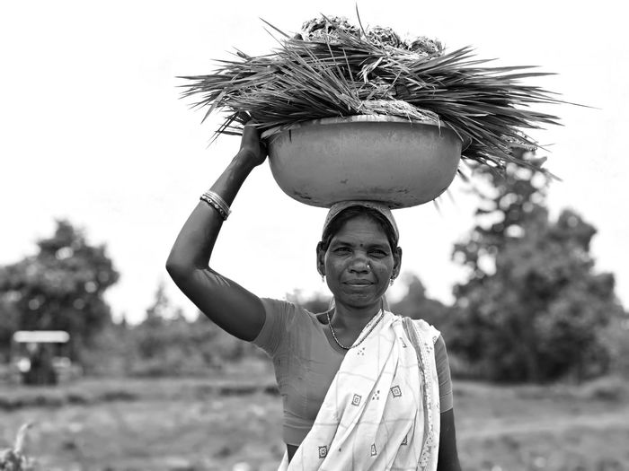 Village View Village Life Smiling Happiness Portrait Women Headshot Standing Sky Carrying On Head Sari Indian Culture  Pretty 2018 In One Photograph International Women's Day 2019