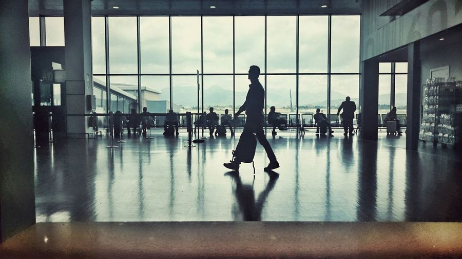 Silhouette people in departure area at milan–malpensa airport