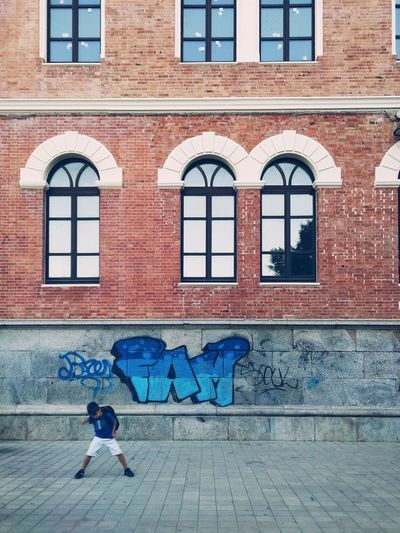 👦✌️ Cagliari Sardegna Sardinia Outdoors Windows Architecture Building Exterior Built Structure People Architecture_collection Kids Graffiti Graffiti Art Graffiti Wall City Life Real People DoorsAndWindowsProject Buildings Urbanphotography Outdoor Pictures One Person Tv_urbex Tv_living BuildingPorn Streetphotography The Street Photographer - 2017 EyeEm Awards Place Of Heart The Architect - 2017 EyeEm Awards Sommergefühle Be. Ready.