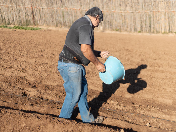 Side view of man working on farm