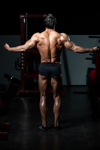 Rear view of man with arms raised