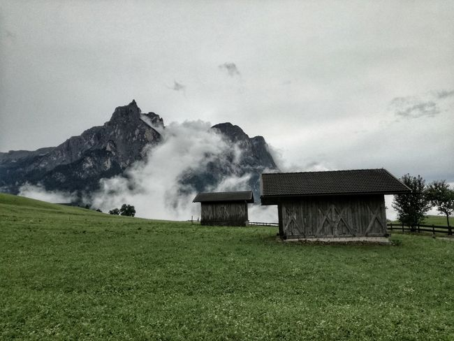 Story of two huts Beauty In Nature Field Agriculture Landscape Nature Rural Scene Alps EyeEm Best Shots No People Outdoors Grass Scenics Day Sky Tree Water Freshness Mountain Range Tranquility Summer Leisure Activity After The Storm Beauty South Tyrol Dolomites