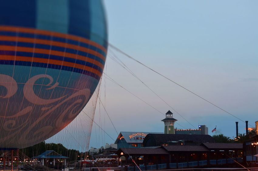 Orlando, Florida; August 19, 2018 Colorful air balloon, pier and boathouse restaurant. Sunset Card. Walt Disney World DisneyWorld Disney Hotels Balloon Disney Store Taxi Boat Mickie Mouse Coca Cola Planet Hollywood Restaurant Art Decor Shopping Rollercoaster Disney Springs Attraction Theme Park Boardwalk Fireworks Summer Show Travel Tourism Italian Food Latin Food Magic