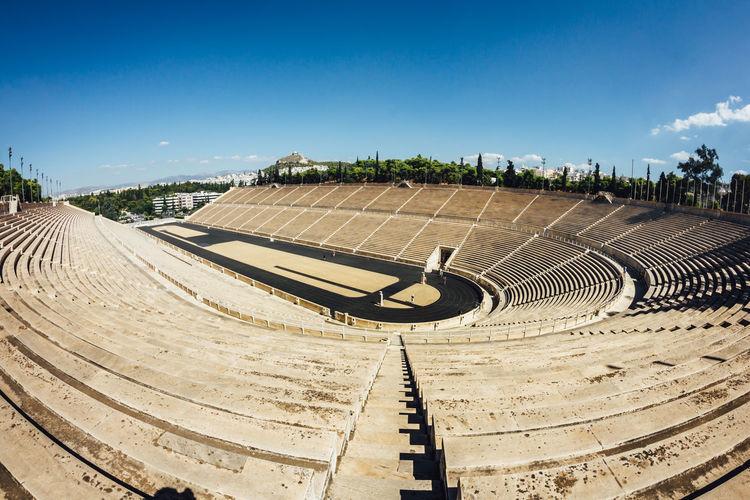 Scenic view of stadium against blue sky