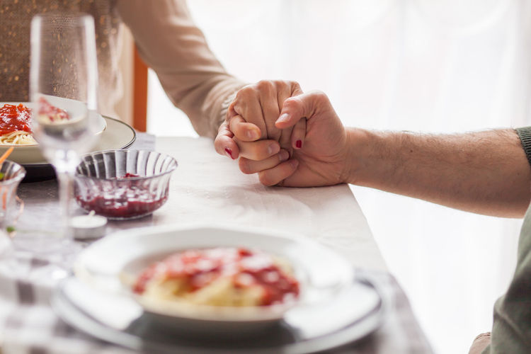 Food Food And Drink Indoors  Real People Freshness Table Two People Human Hand Hand People Adult Kitchen Utensil Men Dessert Holding Eating Utensil Sweet Woman Couple Praying Thankful Glass - Material Horizontal White Lunch