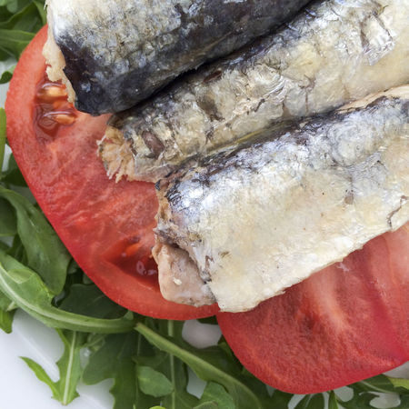 Sardines and tomato slices on a bed of Rocket salad leaves Close-up Detail Directly Above Food Food And Drink Foodporn Freshness Full Frame Healthy Eating Healthy Food Leaves Omega 3 Omega 3 Fatty Acids Omega 3 Oils Organic Rocket Salad Salad Leaves Sardine Sardines Sea Food Still Life Tomato Tomatoes