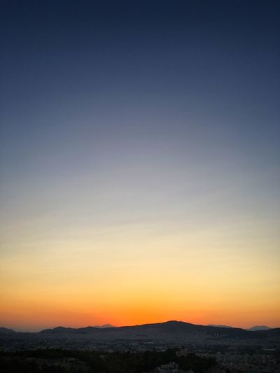 Simple and beautiful sunset Sunset Nature Scenics Tranquil Scene Orange Color Beauty In Nature Tranquility Outdoors Sky Clear Sky Mountain No People Landscape Day Athens, Greece Golden Hour The Week On EyeEm Sunlight Colorful Sunset Skyline Evening Sky After Sunset Sky Just After Sunset FAR AWAY Tourism