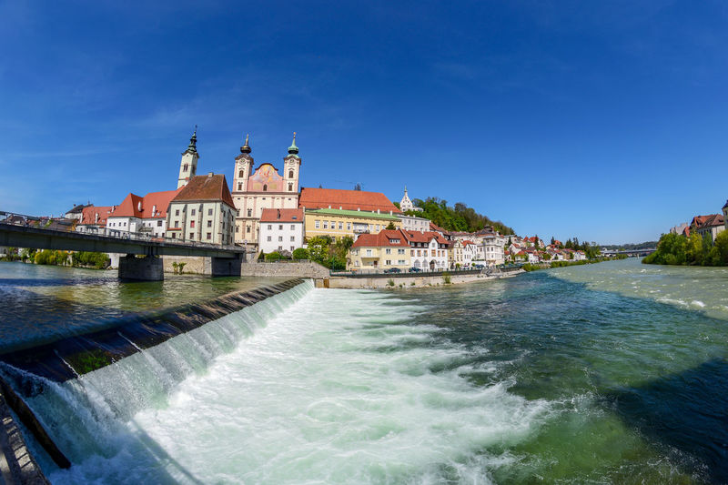 View on Steyr in Upper Austria / Austria Water Architecture Built Structure Building Exterior Sky Travel Destinations Motion Blue Nature Waterfront Tourism Clear Sky Day Travel No People Sea Building Scenics - Nature Flowing Water
