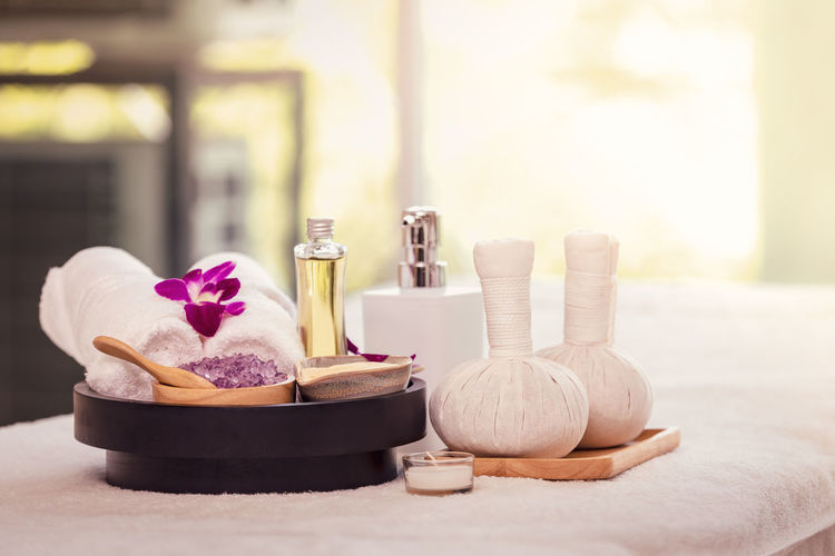 Close-up of spa products on massage table