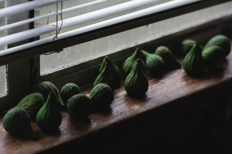 Close-up of figs on window sill