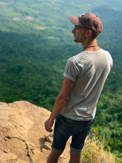 Thailand portrait top of the mountain Mountain Thailand Leisure Activity Real People Casual Clothing Young Men One Person Lifestyles Young Adult Looking Away Outdoors Beauty In Nature Focus On Foreground Land Side View Nature Looking Standing Sunlight Day Three Quarter Length