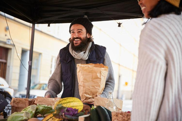 Portrait of a man preparing food at market