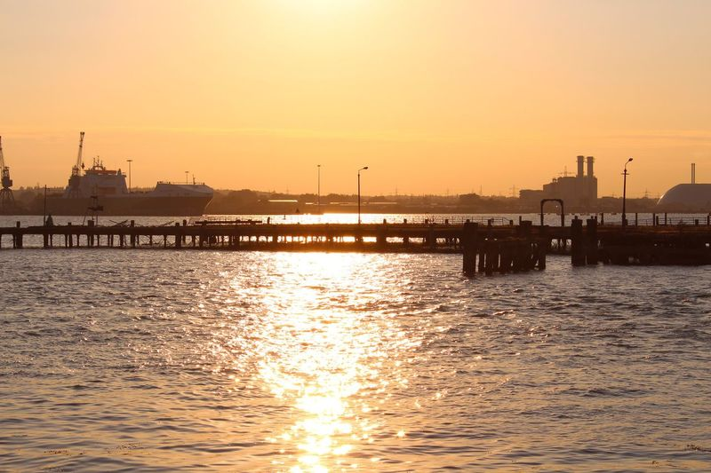 Ship Water Sky Sunset Architecture Sea Built Structure Nature Waterfront Orange Color Pier Beauty In Nature Scenics - Nature Sunlight Building Exterior Reflection Silhouette Sun Tranquility Tranquil Scene