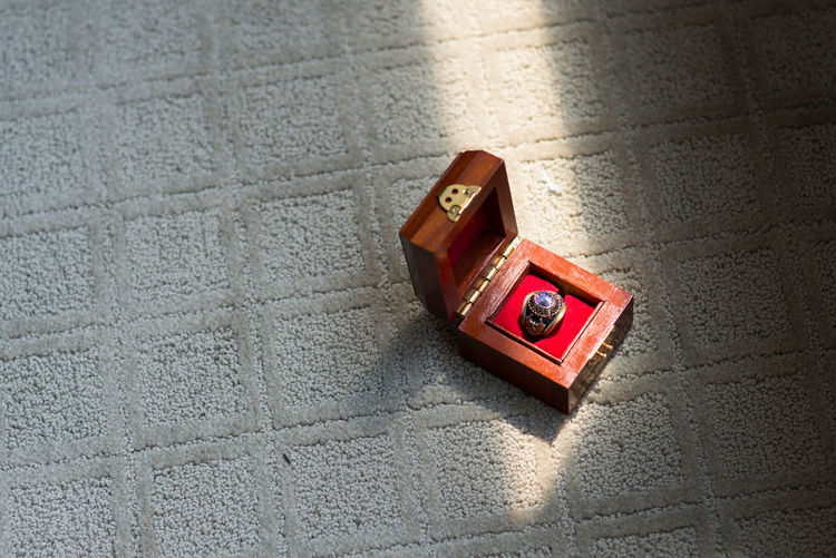 Old ring High Angle View Box Box - Container Single Object Red Day No People Sunlight Close-up Outdoors Jewelry Box Love Luggage Textured  Pattern Container Suitcase Nature Shadow Still Life Concrete Ring Wedding Old Objects Memories