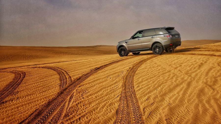 View of car on desert against sky