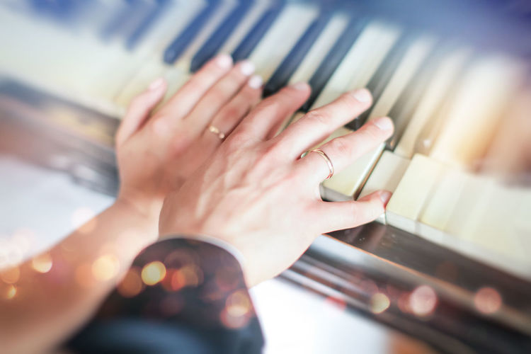 Music Piano Arts Culture And Entertainment Body Part Bridegroom Close-up Finger Hand Human Body Part Human Hand Human Limb Indoors  Lifestyles Music Musical Instrument Real People Rings Selective Focus