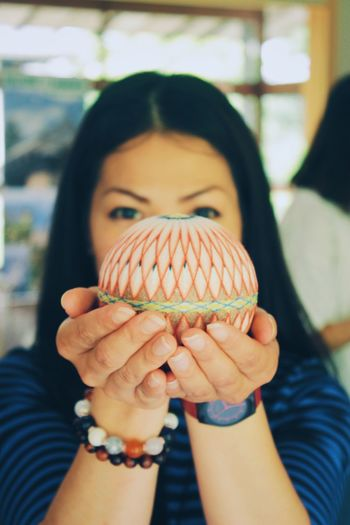"Temari means ""hand ball"" in Japanese. Balls made from embroidery may be used in handball games in 7th century A.D. Real People Holding One Person Human Hand Indoors  Focus On Foreground Lifestyles Childhood Close-up Day Human Body Part People Temari Japan Tradition Embroidery Japanese Culture Culture Of Japan Traditional Culture Culture Culture And Tradition Creativity Handmade Ball Skill  Business Stories"