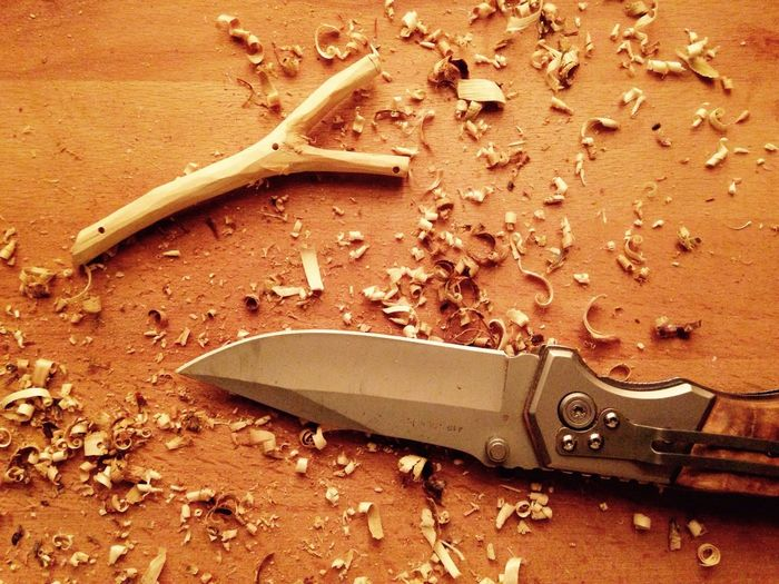 Directly above view of knife by slingshot