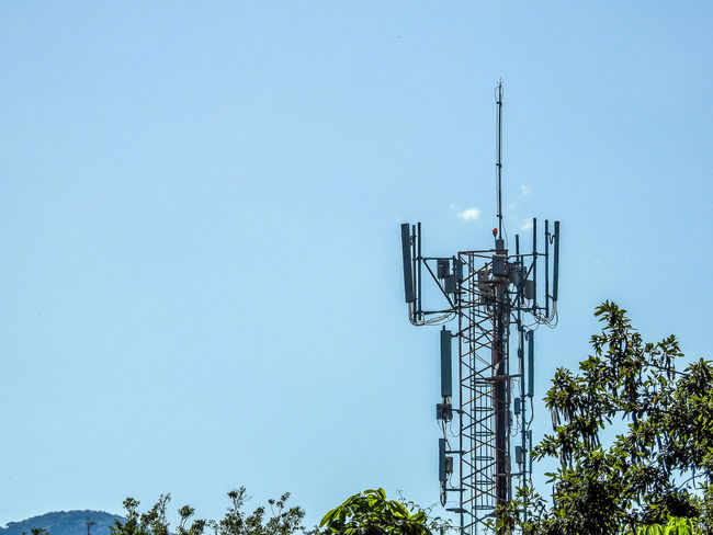Antenna Blue Cellphone Tower Clear Sky Day Low Angle View Nature No People Outdoors Sky Technology Tree