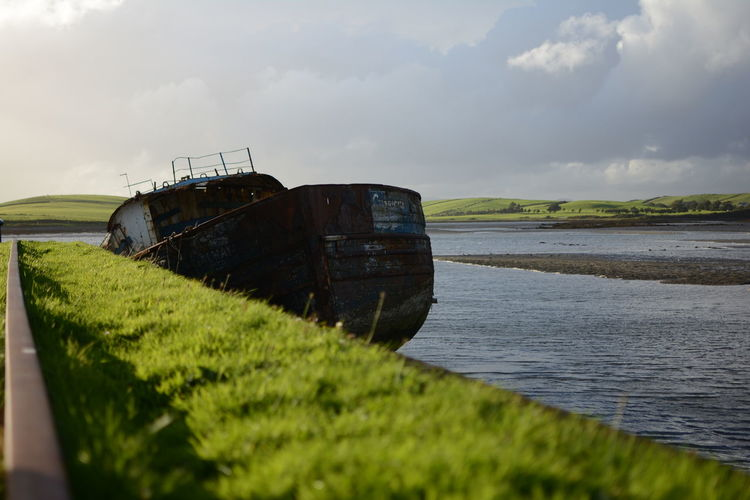Abandoned ship in Westport, Ireland Abandoned Abandoned Places Ireland🍀 Ireland Ire Westport County Mayo Mayo Boat Ship Water Built Structure No People Sea Outdoors Day Rural Scene