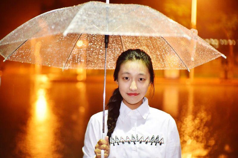 Portrait Of Woman Holding Umbrella