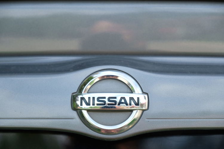 NISSAN LOGO AT CAR Car Brand Almera Nissan Almera Nissan Car Car Land Vehicle Full Frame Metal Close-up Vintage Car Headlight Vehicle Hood Car Point Of View Car Wash