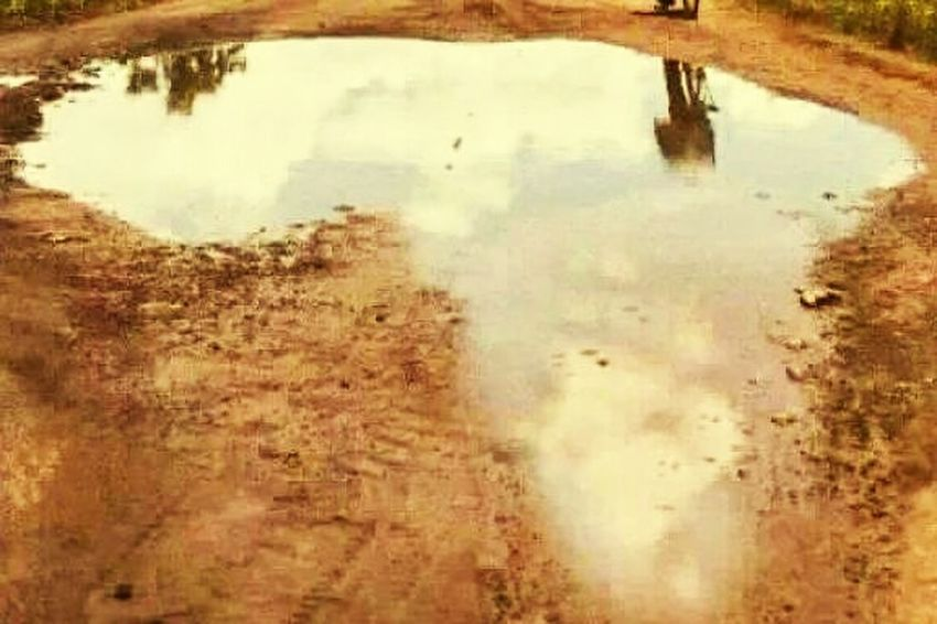 Water puddle shaped like africa.. Natural Art