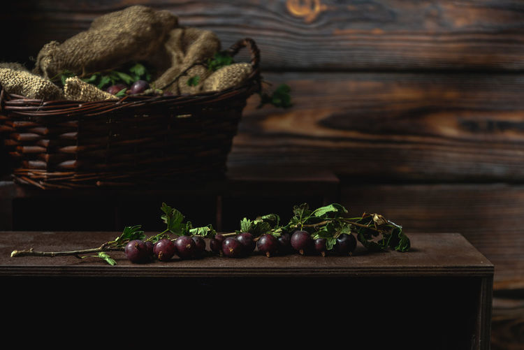 Berries Branch Dark Wood darkness and light Foodphotography Gooseberry Healthy Eating Rustic Style Still Life Summer Food