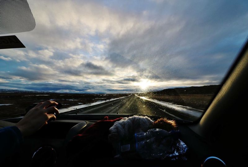 Driving in Iceland Transportation Car Mode Of Transport Land Vehicle Driving Vehicle Interior Car Interior Travel Cloud - Sky Men Windshield Journey On The Move Road Trip Sky Holding Non-urban Scene Car Point Of View Person Iceland