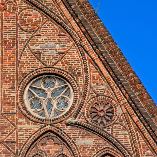 Rosette window and decorated brick wall, part of the Gothic church of the Bijloke Abbey in Ghent, Flanders, Belgium Abbey Belgium Brick Wall Church Flanders Flanders Fields Gothic Sunny Architecture Bijloke Brick Building Exterior Built Structure Historic Historic Buildings Historic Town History Masonry Medieval Place Of Worship Religion Rosette  Spirituality Window Frame
