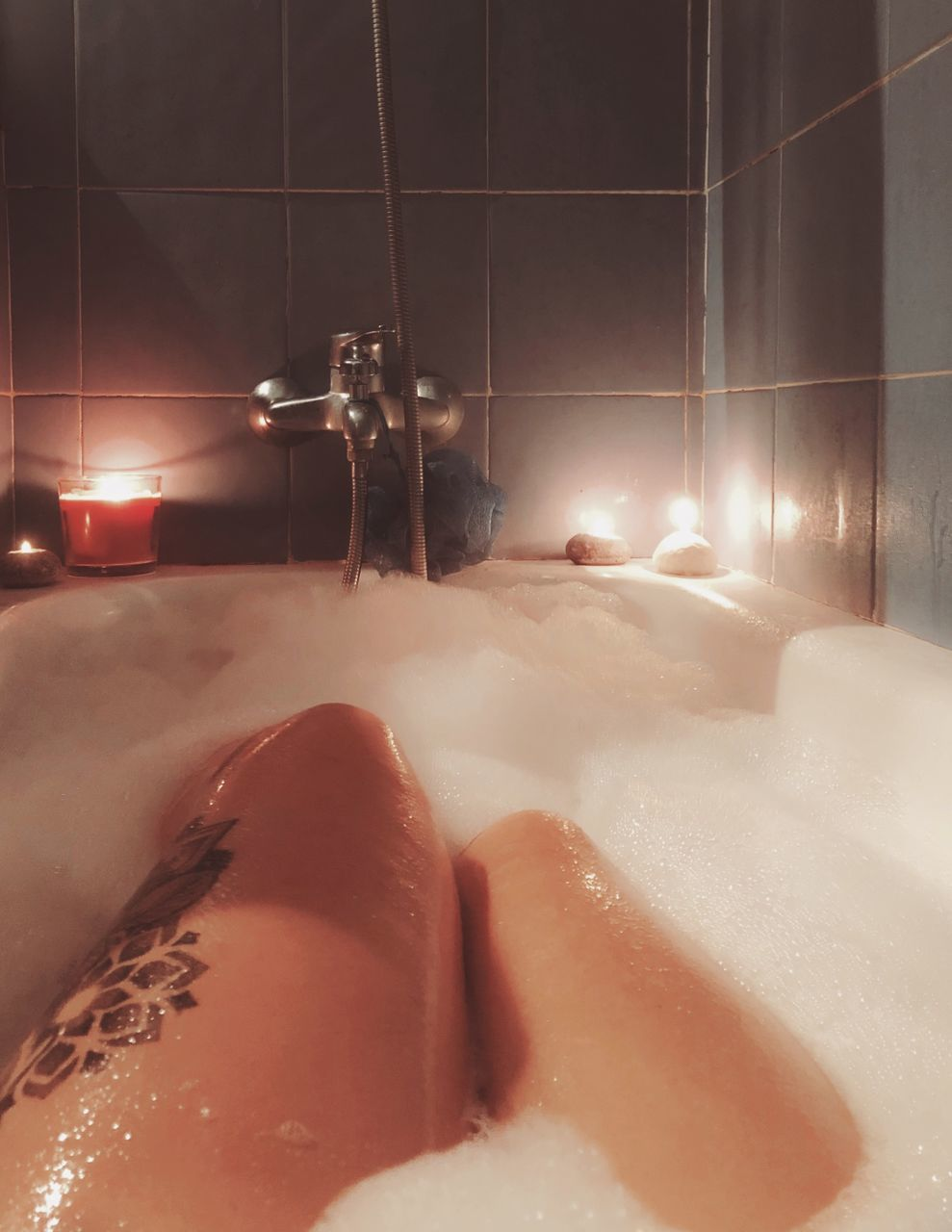 bathroom, domestic bathroom, bathtub, domestic room, human body part, taking a bath, home, indoors, hygiene, body part, wet, nature, bubble bath, low section, one person, relaxation, soap sud, lifestyles, body care, luxury, human foot