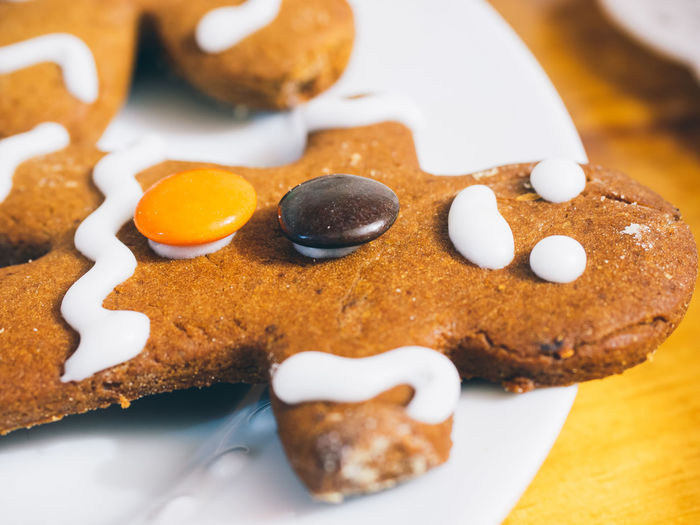 Close-up of gingerbread man served on table