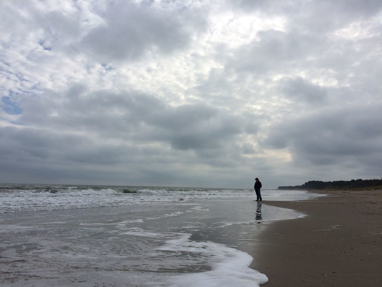 View Of Man Standing On Beach