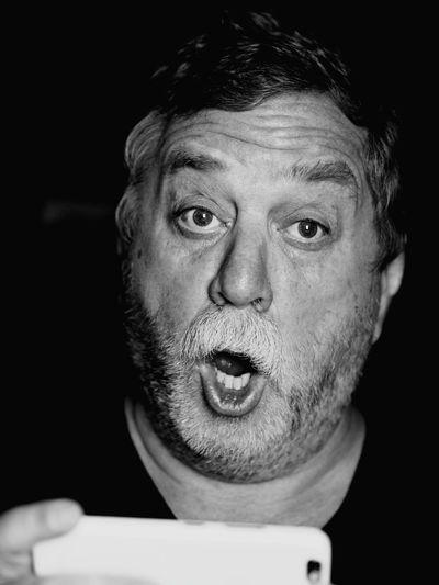 Close-Up Portrait Of Senior Man Photographing In Darkroom