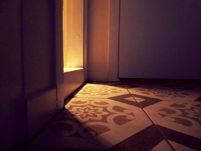 Sunlight falling on floor of house