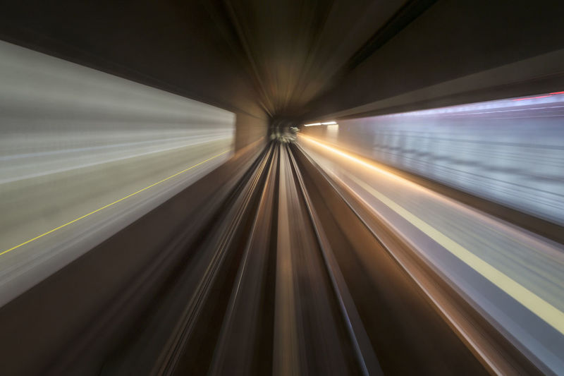 Motion blur of a city and tunnel from inside a moving monorail in Kuala Lumpur. Image has grain or subject is blurry or noise or out of focus and soft focus when view at full resolution. Blurred Motion Diminishing Perspective Full Frame Illuminated Long Exposure Modern Motion Moving Walkway  Multi Colored Sky Speed Subway Station The Way Forward Transportation Vanishing Point