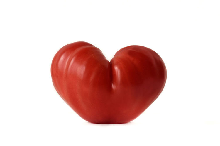 Heart shaped tomato on white background- Love concept Benefit Love Natural Red Shape Vegetarian Food Beef Heart Carotenoid Pigment Coeur De Beuf Concept Design Food Health Healthy Heart Ideas Lycopene Nutrition Organic Shaped Tomato Vegan Vegetable Vitamin White