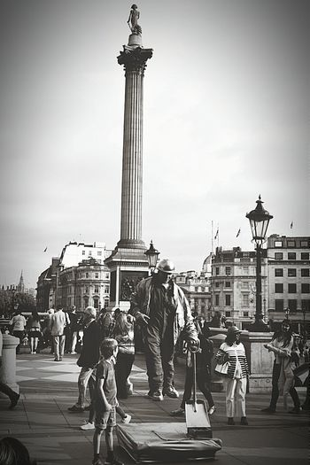 Street Performer Mesmorized Little Boy Capture The Moment Trafalgar Square Nelson's Column LONDON❤ My City London London Life London Streets People Watching Old Buildings Street Photography Street Lamp Black And White Black & White Black And White Photography Nikon D3200 The Street Photographer - 2016 EyeEm Awards